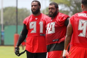 Bucs DE Robert Ayers, Jr. and DT Chris Baker - Photo by: Cliff Welch/PR