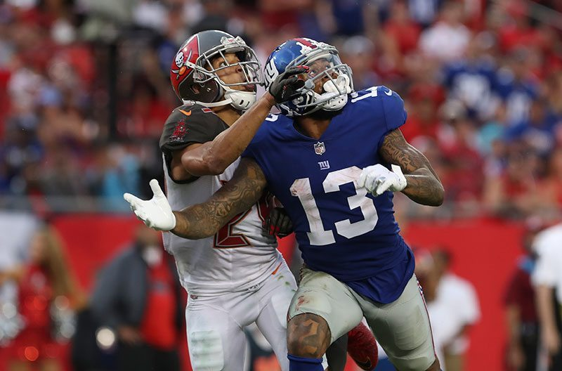 CB Brent Grimes and Giants Wr Odell Beckham Jr. – Photo by: Mark Lomoglio/PR
