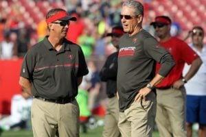 Bucs OC Todd Monken and head coach Dirk Koetter - Photo by: Cliff Welch/PR