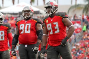 Bucs DT Gerald McCoy and former DT Chris Baker - Photo by: Cliff Welch/PR