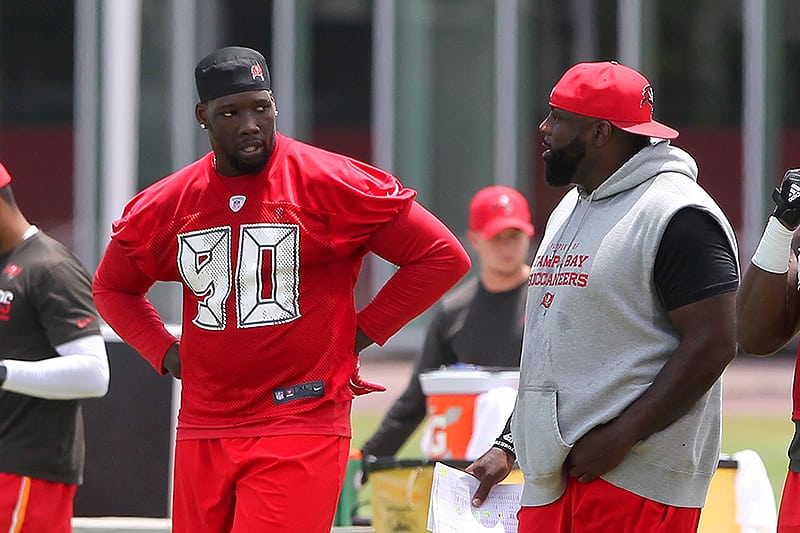 Bucs DE Jason Pierre-Paul and DL coach Brentson Buckner - Photo by: Cliff Welch/PR