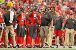 Bucs DC and LBs coach Mark Duffner and DT Gerald McCoy - Photo by: Cliff Welch/PR